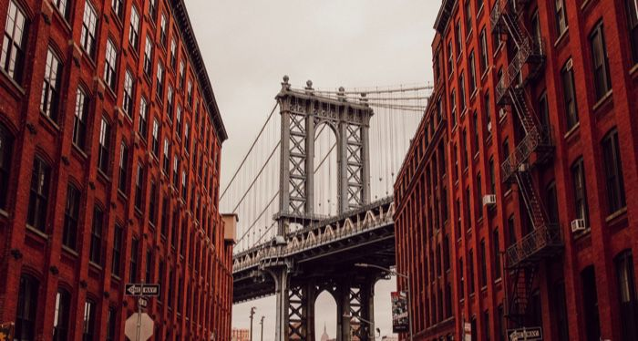 Brooklyn New York view of the bridge between two brownstone buildings