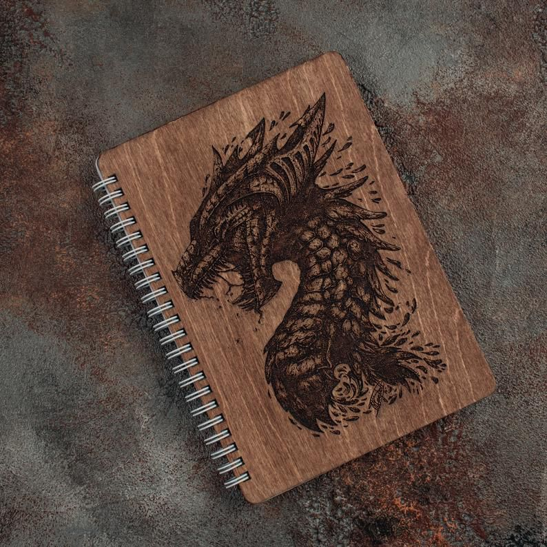 Engraved wooden dragon notebook