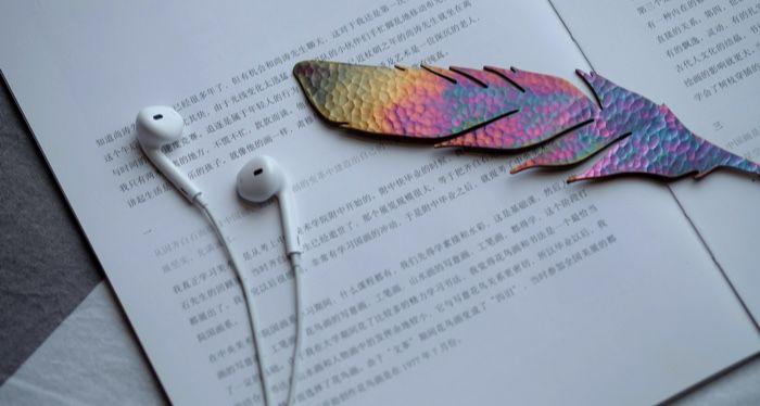 bookmark on book with headphones