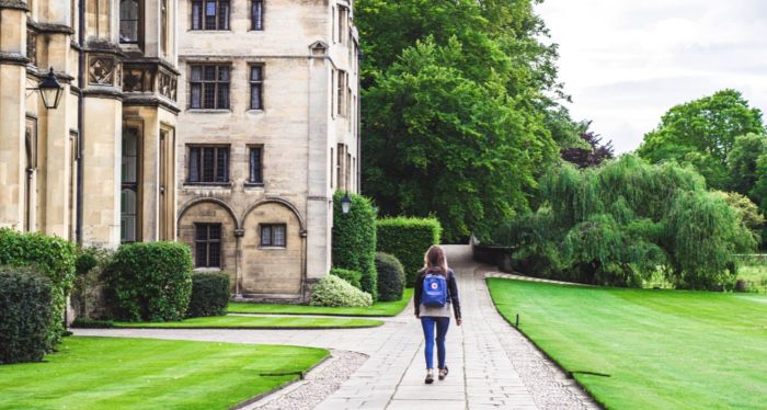 college student walking through university campus