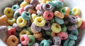 colorful froot loops breakfast cereal in a white bowl