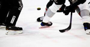 knee down image of hockey players playing hockey