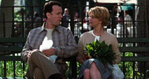 meg ryan and tom hanks sitting on a park bench in you've got mail film
