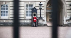 royal guard standing beyond the gates of buckingham palace