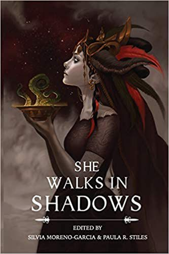 a woman with a dark dress and a feathered piece on her head. It's the cover of She Walks in Shadows