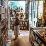 woman browsing books in bookstore