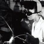 woman in a factory welding during World War 2