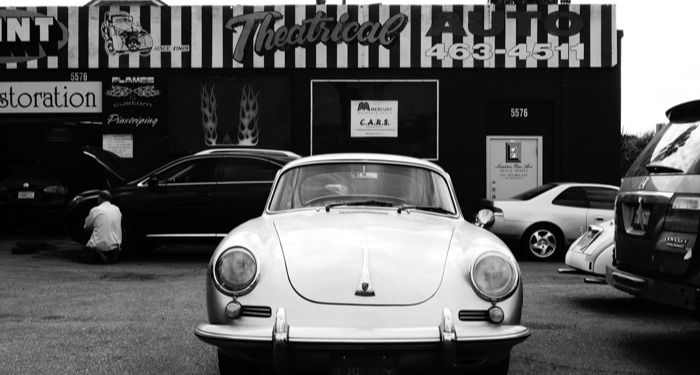 1950s car in front of a shop in black and white