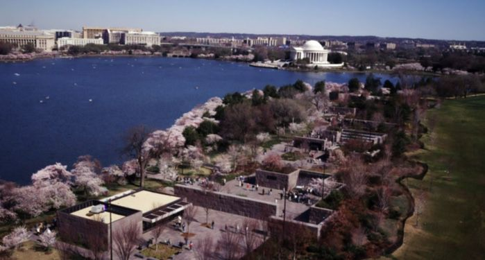 Aerial view of Washington, D.C., showing the FDR Memorial in the foreground at Cherry Blossom Festival time