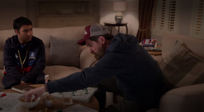 A still of episode 10. Beard and Nathan are sitting in Ted's living room. In the background is the Rhyming Slang book, opened.