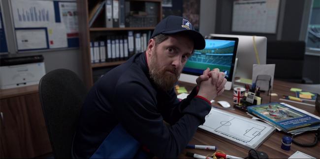 Beard looks upset at his desk