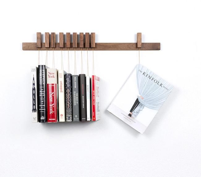 Walnut book rack with cookbooks suspended