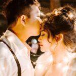Asian couple kissing forehead