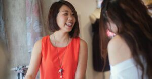 asian woman smiling and laughing with a friend