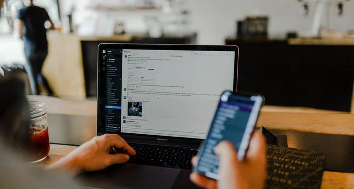 person using phone and laptop at the same time https://unsplash.com/photos/gUIJ0YszPig