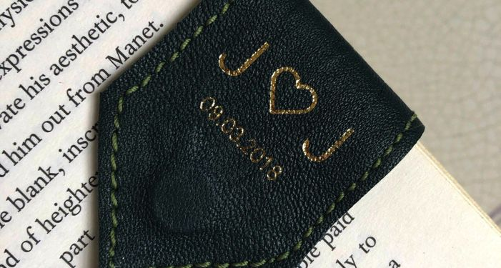 a personalized green leather bookmark