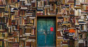 books surrounding a blue door