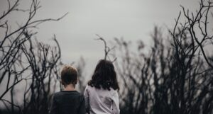 children in a creepy field for horror