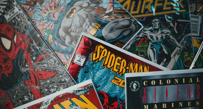 image of several comic books in a messy pile https://unsplash.com/photos/8SeJUmfahu0