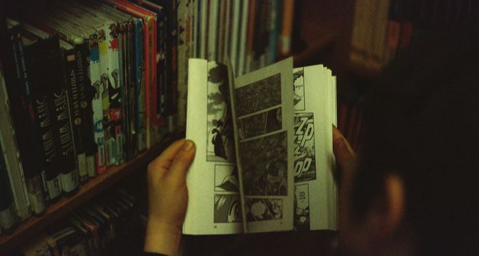 image of a child holding a comic book https://unsplash.com/photos/BfGuQJpDolQ