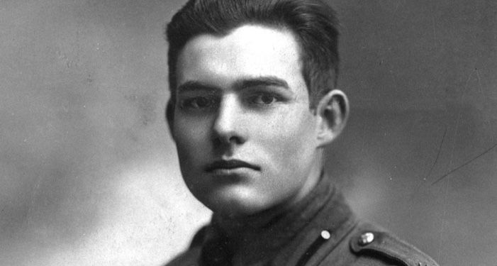 closeup of black and white portrait of Ernest Hemingway in military uniform https://commons.wikimedia.org/wiki/Category:Ernest_Hemingway#/media/File:Ernest_Hemingway_in_Milan_1918_retouched_2.jpg