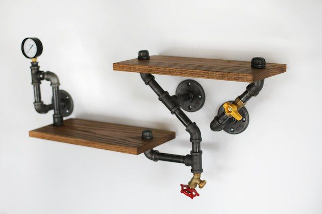 iron pipe connecting 2 wooden shelves