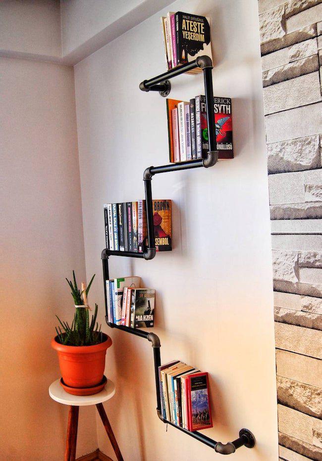 large iron pipe wall bookshelf