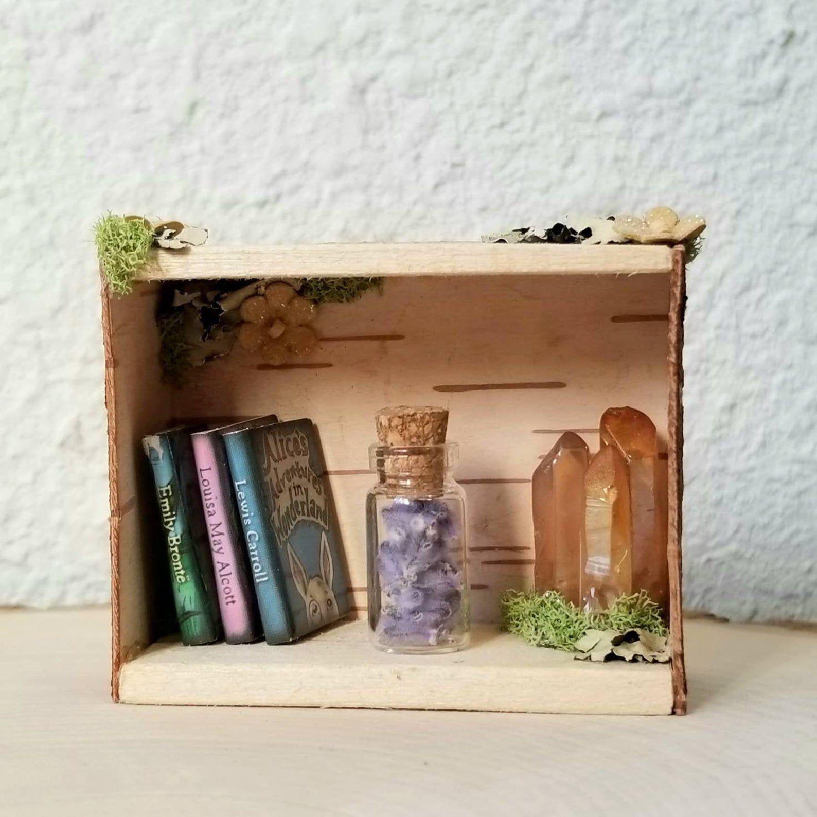 miniature bookshelf with crystals
