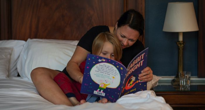 mother reading a bedtime book to her child
