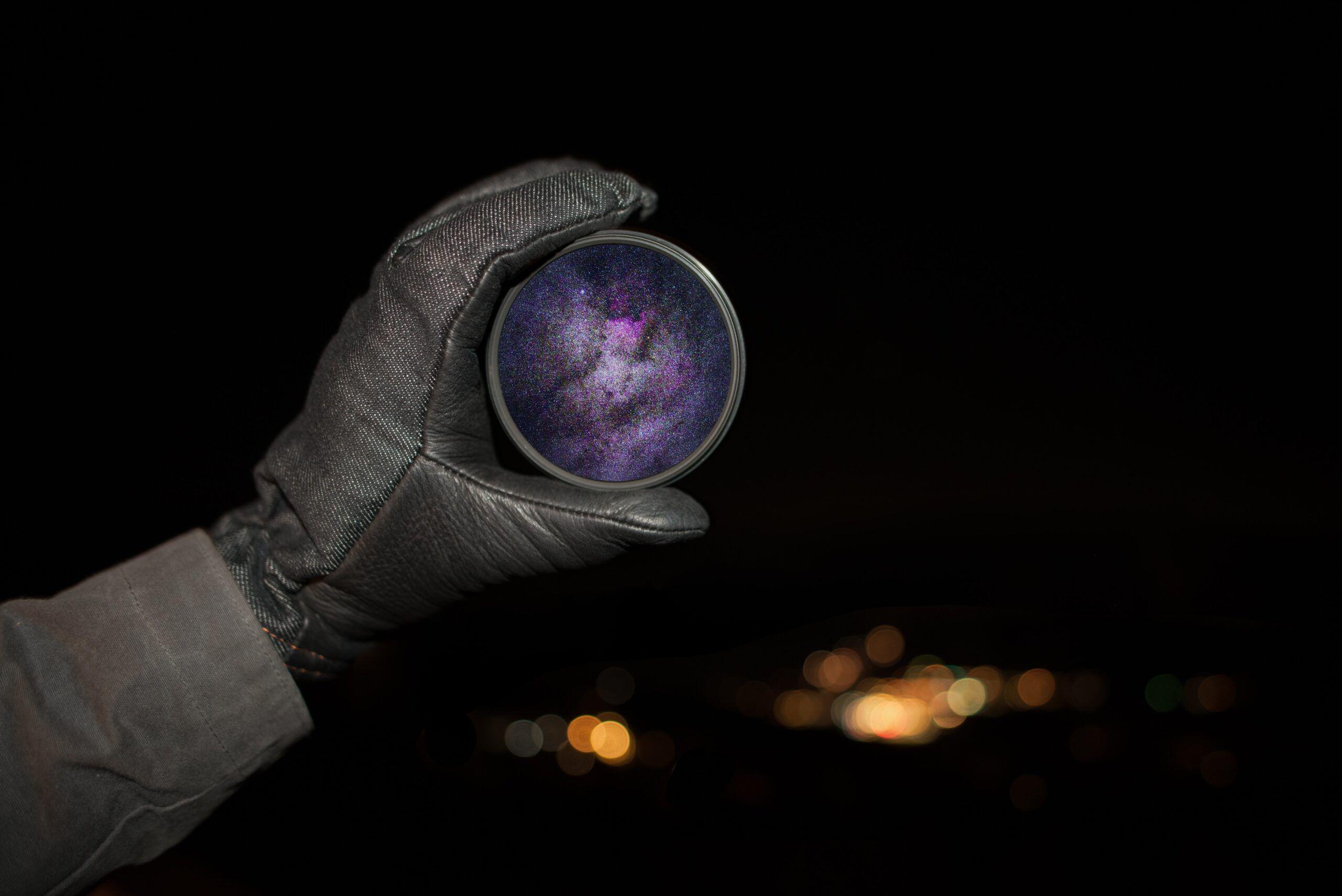 person holding round purple case