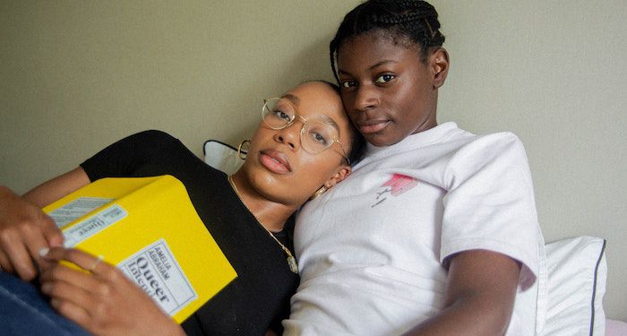 queer Black couple with book
