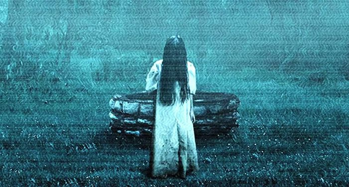 still frame from The Ring movie adaptation: a girl in white with long black hair covering her face emerging from a well https://www.imdb.com/title/tt0298130/mediaviewer/rm104285952/