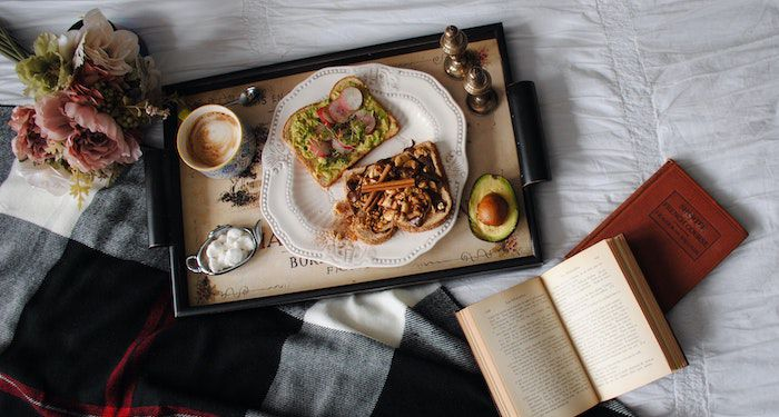 tray of food and a book