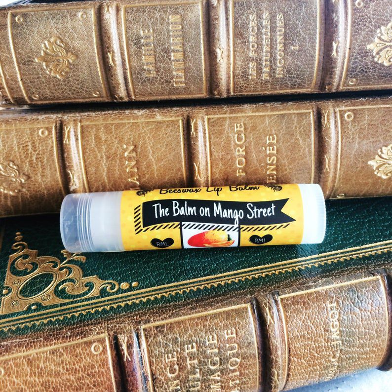 Balm on Mango Street lip balm in front of old books.
