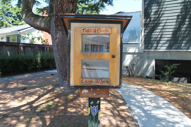"""Fernwood Little Free Library painted with """"Take a book, leave a book"""""""