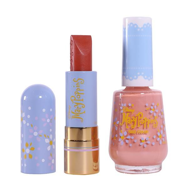 Lipstick with a blue Mary Poppins themed case next to pink nail polish