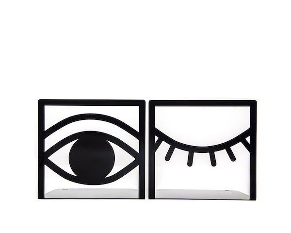 Image of metal bookends. One side has an open eye and the other has a closed eye.