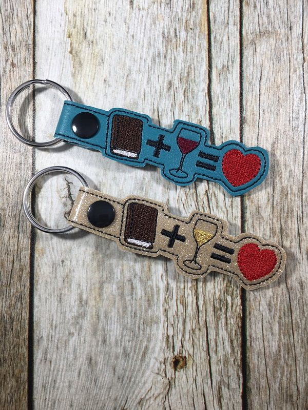 book and wine keychains
