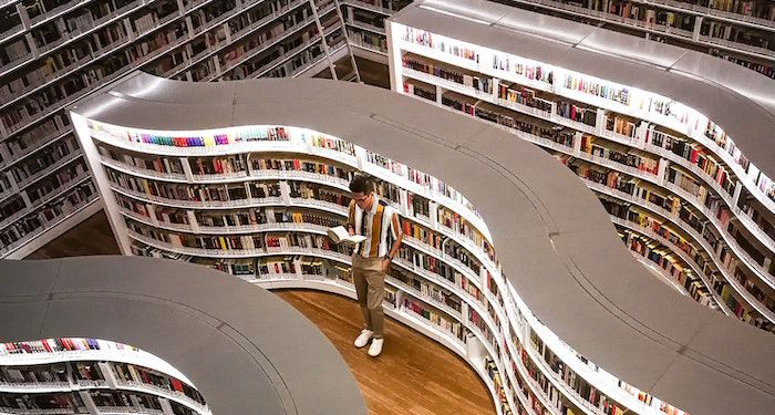 Man standing in bookstore