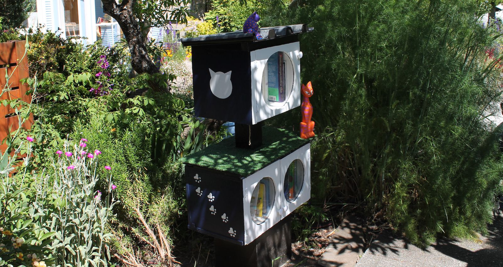 Little Free Library with cat figurines