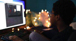 a child using a desktop computer https://unsplash.com/photos/zc9pWsPZd4Y