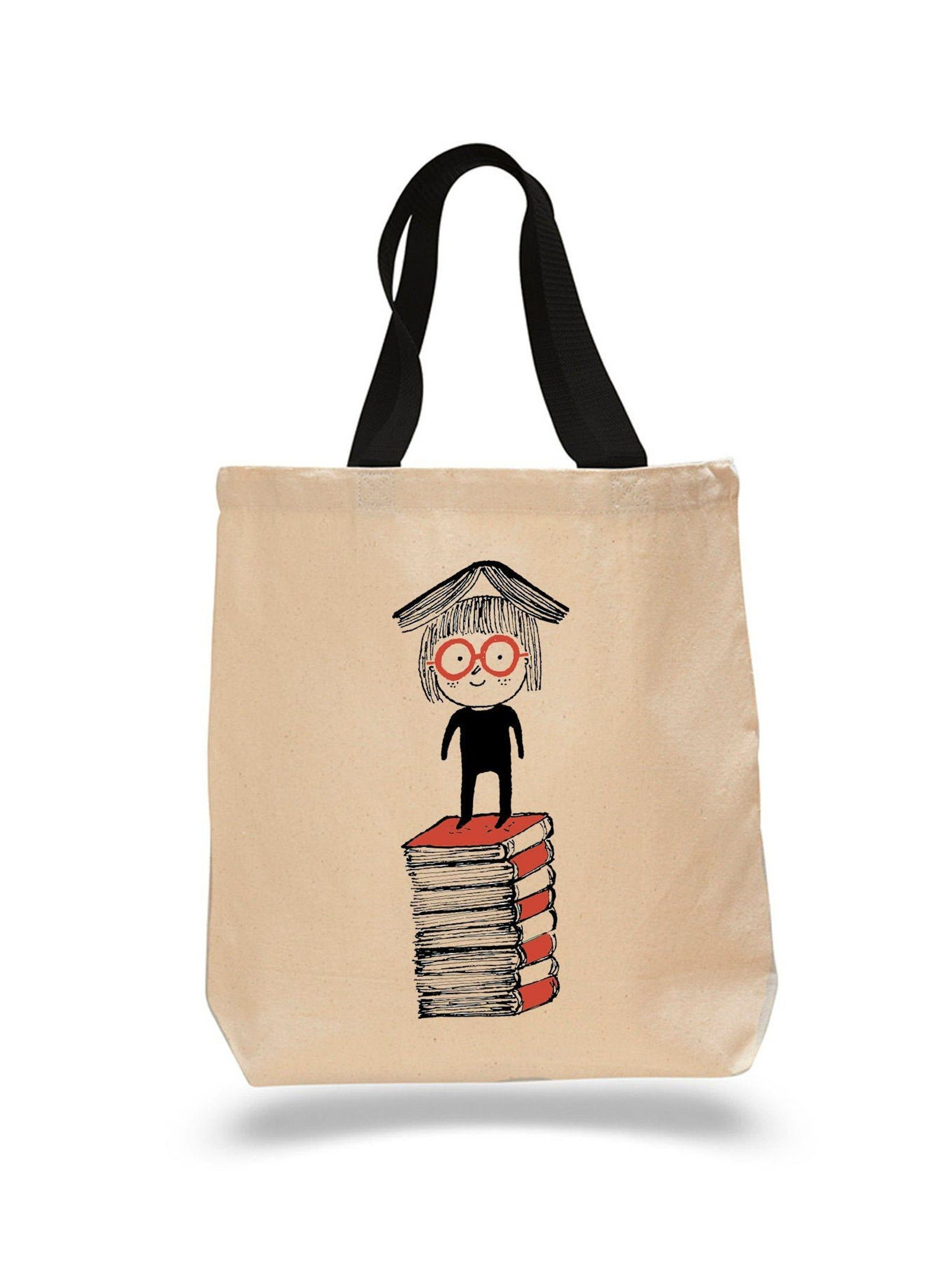 Tote bag with a cartoon character balancing a book on his head
