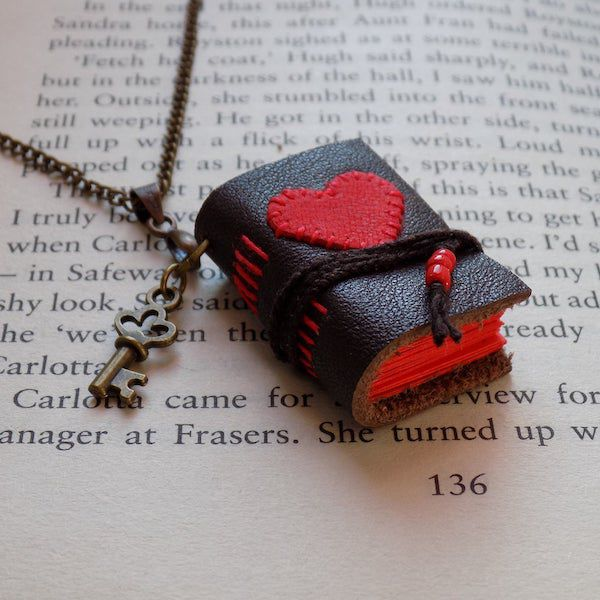 mini leather book with red heart necklace