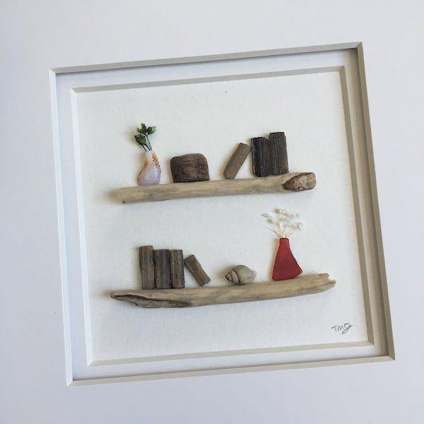 pebble and driftwood art bookshelf