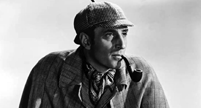 black and white image of Basil Rathbone in The Adventures of Sherlock Holmes film