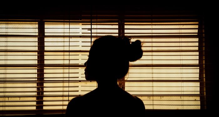 silhouette of a woman standing in front of a window https://unsplash.com/photos/vVINLKZtGOI