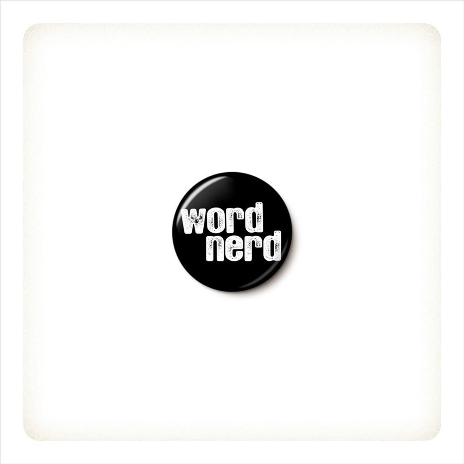 """A black pin that reads """"word nerd"""" in white lettering."""
