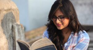 young indian woman or teen reading a book