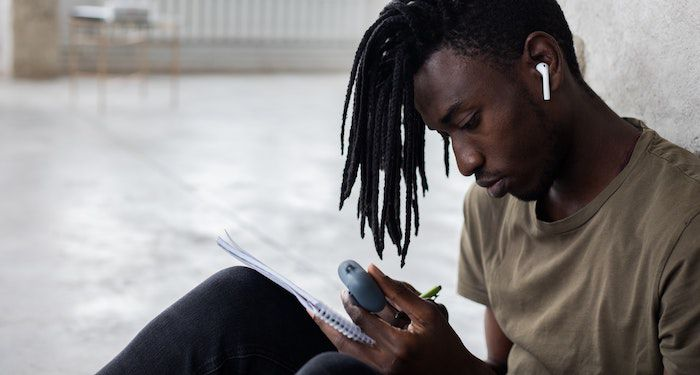Black man writing for poets feature