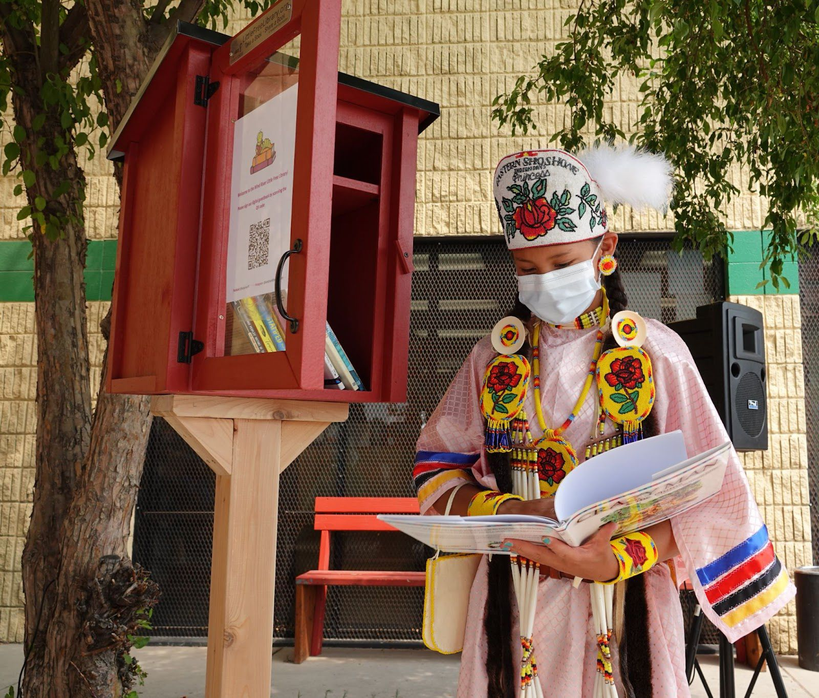 Image of Eastern Shoshone Indian Days Princess Janae Todd, with the new Little Free Library. Image provided by Little Free Library.